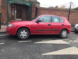 red nissan good condition has roof rack if needed