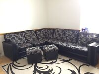 BLACK RAYON MATERIAL CORNER SOFA WITH TWO SOFA CHAIRS