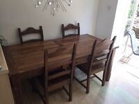 Solid oak dinner table with 6 oak chairs