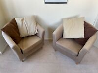 Brown fabric armchairs with cushions