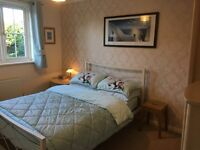 Double bedroom with separate bathroom available in modern home in Heavitree