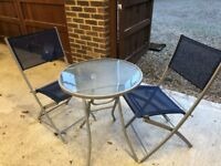 Glass topped garden table and two chairs