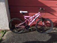 Woman's pink full suspension push bike