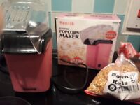 Pink electric popcorn machine with 500g of kernals