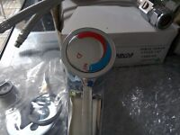 Two new spray mixer lever taps with temperature control