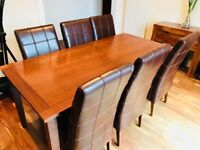 Quality dark oak dining room table (chairs not included)