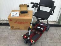 RED LUGGIE ELITE MOBILITY SCOOTER, FREE DELIVERY,EXCELLENT CONDITION