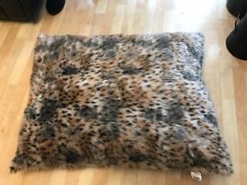 Brand new dog bed/cushion measures 34 inches by 26 inches approximately