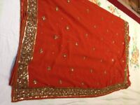 Beautiful orange georgette saree with gold embroidery and sequin work! Offers welcome