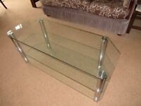 Large plate glass TV stand/ table in good condition.