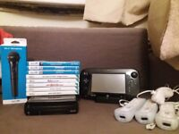Wii U + 3 controllers + Wii U microphone + 8 games