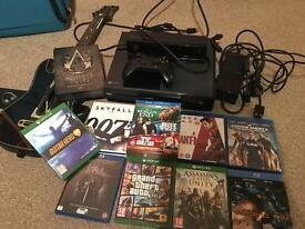 XBOX ONE 500GB BUNDLE. INCLUDES ASSASSIN'S CREED UNITY BASTILLE EDITION & GAMES, AND BLU-RAY MOVIES