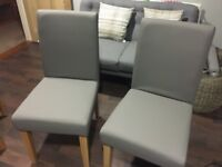 4 faux leather grey dining chairs (as new)