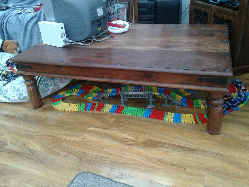 A heavy solid indian rosewood coffee table 135 x90 cm good a heavy solid indian rosewood coffee table 135 x90 cm good condition geotapseo Choice Image