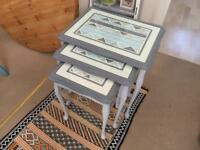 Solid wood nest of three tables - grey and white with geometric pattern and glass tops