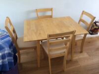 Solid wood dining table and 4 matching chairs