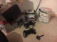 PS3 Slim Boxed with 2 controllers + 24 games