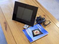 Digital photo frame - unused, boxed. With instructions, cables, remote control, screen cleaner.
