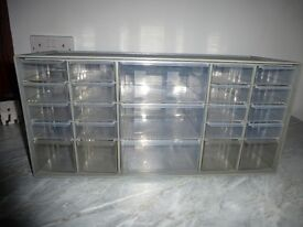 Plastic box with 16 small drawers