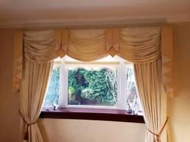 Cream curtains and pelmets