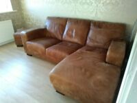 BROWN LEATHER CHAISE STYLE SOFA AND POUFFEE