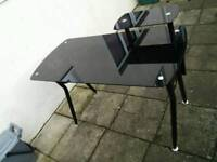 Black metal computer desk with glass top and removable shelf