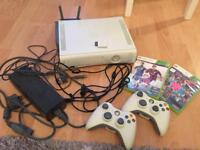 Xbox 360 with 2 controllers 2 games and plug and charge kit