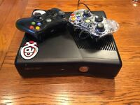 Excellent condition XBOX 360 with 8 games, 2 controllers & 250GB hard drive.