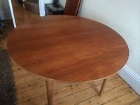 Early 1950s Danish Designer Teak and Oak Extending Dining Table