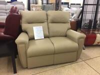 Sitting pretty beige leather 2 seater sofa