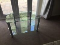 Glass TV stand with chrome legs. 80cm W x 50cm H x 42cm D