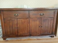 Dark solid wood sideboard in good condition for sale in Carshalton Beeches