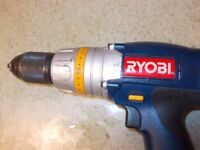 Ryobi 18 v heavy duty hammer dril with charger and two plus one batteries
