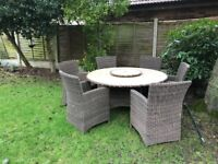 High back wicker chairs and Marble effect table in brown