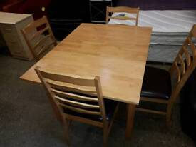 Oak table and chairs with hidden leaf