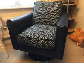 Almost new Swivel armchair 'Avici' pattern material with circular Chrome base 7 months old.