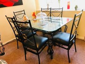 Strong glass and iron dining table for 6
