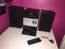Sony CMT-FX300i Micro Hi-Fi System. Enjoy AM/FM radio, play CDs and MP3 And iPod/iPhone Dock