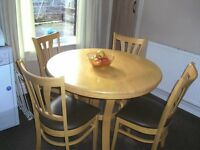 Light Oak table and 4 chairs.