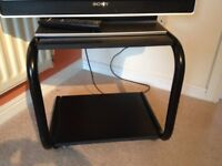 Lovely black wood and metal Televison and Media table with wheels - good condition