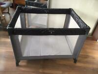 Mothercare travel cot and mattress.
