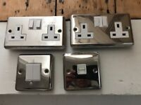 Assorted chrome sockets/ light switches