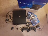 Ps4 pro 1tb with 3 games and 2 controllers