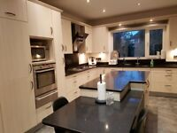 Used complete high quality kitchen c/w units, appliances, quartz/granite worktop