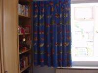 Boy's royal blue lined curtains with cars/scooters/helicopters....