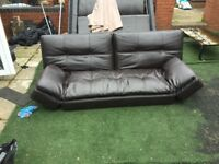 Low to the ground sofa/bed, ideal for a games room.
