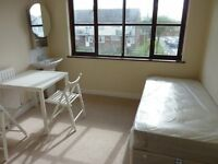 Light bright double room for one near shops and buses, rent incl wi-fi, council tax and most bills