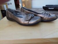 Size 8 gold coloured leather. Cotton traders flat shoes