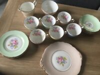 Vintage tea set with 6 cups, saucers and side plates plus milk jug, sugar bowl and sandwich plate