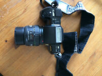 Pentax F7 35mm camera with case and strap.